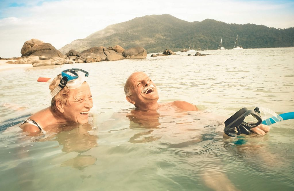 Retired couple swimming and snorkelling